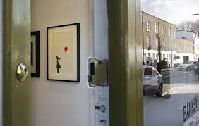 banksy s self defeating painting doubles in value after being sold for 1 1