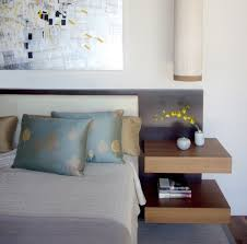 Designers offer attach the side tables to the bed. bed side