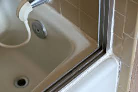 to clean your shower door tracks