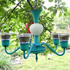 easy homemade bird feeder made with an old light fixture and a few other inexpensive