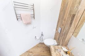modern bathroom white. Exellent Bathroom Banque Du0027images  Toilet In The Bright And Minimalist Interior Of Modern  Bathroom White Walls Inserts Tiles Under Color Wood With Modern Bathroom I