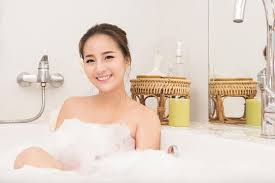Download Bathing Woman Relaxing In Bath Smiling Relaxing. Asian Young Woman  In Bathtub. Stock