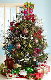 Pink Colorful Christmas,Pier 1 Pink Present Dcor tops a tree with assorted  ornaments in bright, happy colors