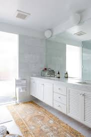 white floating vanity with traditional unique rug for contemporary bathroom ideas and design