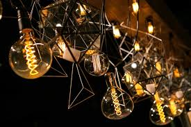 Unique lighting designs Home Indoor Unique Lighting Concept With Hanging Light Bulbs And Geometric Shapes Suspended From Wooden Board Inside Weddings Reception Décor Photos Unique Geometric Lighting Design Inside