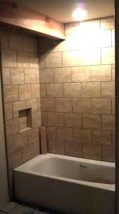tub surround with window tiling a