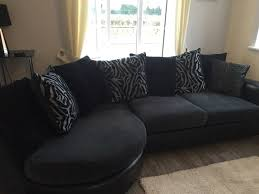 dfs sofa for with swivel chair and footstool black leather and grey black