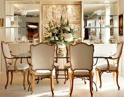 dining room table mirror top: mirrored shelving and table top are decorative in a traditional setting carved artistry and vintage seating bring together a well styled dining room
