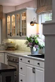 over the sink lighting. kitchen love the sconce over counter white cabinets and natural light sink lighting