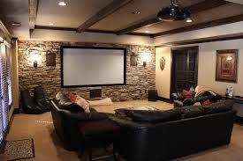 decorations attractive vintage media room design wooden beam ceiling black leather sofa exposed stone wall cool wall lamp white movie screen cream black leather sofa perfect