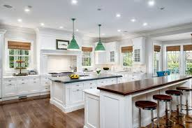 white cabinet kitchen with wood counter breakfast bar island with aro stool seats