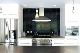 black subway tile kitchen with white cabinet and tiles x matte backsplash wh