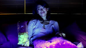 woman watching tv at night. gma writer goes on a 24-hour tv series marathon to get new ideas woman watching tv at night