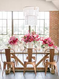 Copper tolix chairs with pink flower table setting