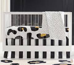 the emily meritt leopard print crib