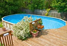above ground swimming pool ideas. This Raised Deck Sits On The Far End Of An Oval Above-ground Pool. Above Ground Swimming Pool Ideas