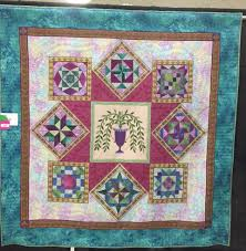 Innocent Until Proven Quilty & and here is ShangriLa hanging at the quilt show. If you are near San Antonio,  Tx this weekend you should come out and see our 300 beautiful quilts and  shop ... Adamdwight.com
