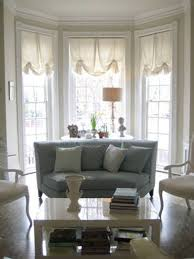 Bay Window Decorating With White Roman Shades ...