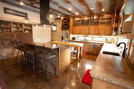 rustic corrugated metal ceiling kitchen rustic with concrete countertops copper countertops window between cabinets