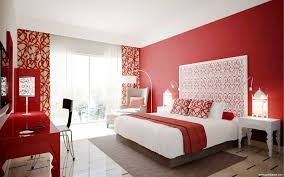 excellent red and white bedroom designs showing red painted wall and white bedding sets combine red blanket plus long red study tabl and antique lantern