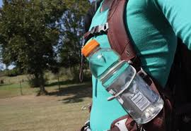 a backpack s trekking pole attachment makes for a good makeshift water bottle holder