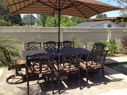 flamingo outdoor patio 9pc dining set with 44 x 84 rectangle table includes 2 swivel rockers 6 standard dining chairs 6 5 x 10 5 rectangle umbrella