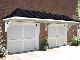 pictures of hip roof pergola over garage doors from atlanta decking and fence pany