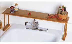 Amazon Com Lipper International 8879 Bamboo Wood Over The Sink Kitchen Shelf 30 X 6 1 4 X 9 Home Kitchen