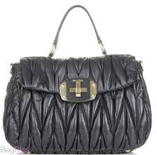 Rachel Bilson Style: Miu Miu Matelasse & Miu Miu Metalasse Bag Adamdwight.com