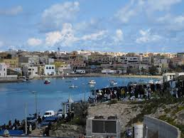 First Libyan Refugees Arrive In Lampedusa