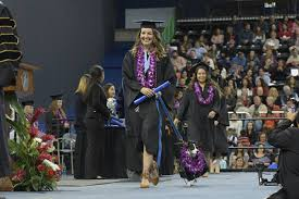 college grad receives diploma alongside service dog who made it  taylor dearman and her medical alert service dog skittles walk the stage during the fall 2017 commencement ceremony