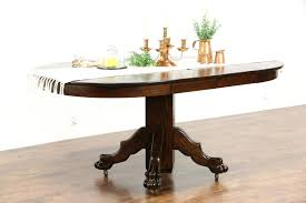 oak antique round dining table 2 leaves carved lion paw and chairs