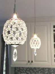 glam lighting. crystal pendant lights over a peninsula bring touch of glam to this transitional kitchen master bedroom pinterest lighting i