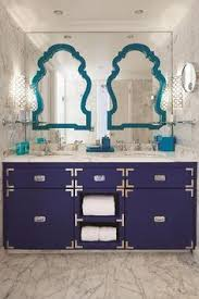 bathroom features gray shaker vanity: contemporary bathroom features a navy campaign vanity topped with gray and white marble fitted with his