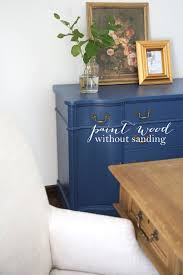 blue buffet painted over stained wood with sandpaper