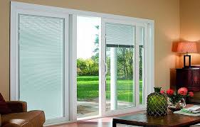 sliding patio doors with blinds between the glass