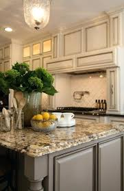 tan painted kitchen cabinets. Tan Kitchen Cabinets Antique Ivory With Black Brown Granite And Coordinating Island Paint Cabinet . Painted