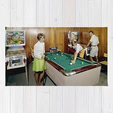 1960 s game room with pinball and a pool table in the admiral motel in wildwood
