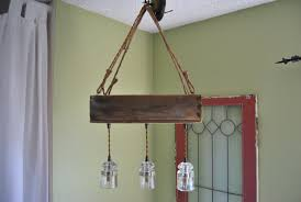 country style diy hanging rustic farmhouse chandelier made from rope and reclaimed wood combined with glass insulator for farmhouse foyer ideas