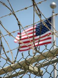 photos inside guantanamo s prison newshour an american flag flies over the detention facility at guantanamo bay photo by