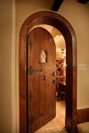 wine cellar doors wine cellar rustic with arched door ascot small glass fireplace doors small