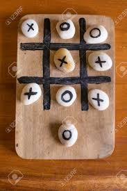 Game With Stones And Wooden Board StoneTictactoe Wooden Board Game With Clipping Path Stock Photo 18
