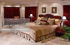 Charming Large Master Bedroom With Red Curtains   Stock Photo