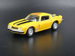 The character is a member of the autobots. 1977 Chevy Chevrolet Camaro Bumblebee Transformers 1 64 Scale Diecast Model Car Ebay