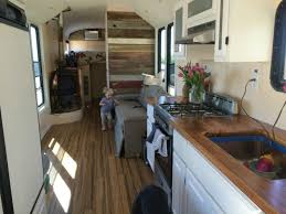 midwest wanderers living big in a tiny house bus conversion bus house