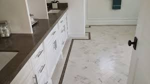 floor tile borders. HERRINGBONE TILE ON FLOOR WITH BORDER LINE AND CAESARSTONE SLAB Floor Tile Borders