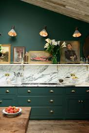 devol kitchens forest green cabinets marble and a shelf with art