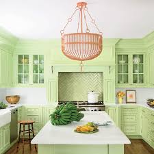 light green kitchen cabinets with c pink chandelier