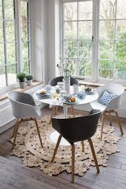 summer hygge inspiration let the light in this corner dining nook is surrounded by windows allowing natural light to flood in