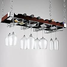 hanging against the wall in the kitchen.Espresso Bottle and Stemware  Ceiling Rack at Wine